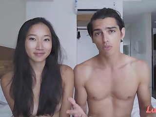 Young slim Asian with small boobs has romantic sex with her caucasian boyfriend