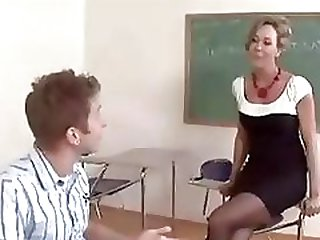 Horny blonde teacher Brandi gives her young student a lesson in sex education
