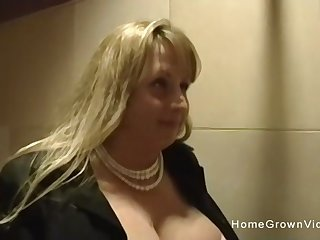 Thick and busty milf sucks my cock in the bathroom
