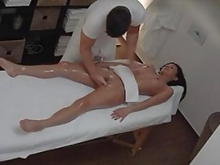 Brunette Sexy Gal Secretly Bangs on Massage Table