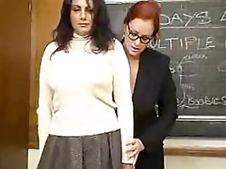 Busty lesbian teacher fucks her student with her toy