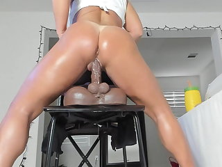 Tight pussy slowly sliding up and down a dildo