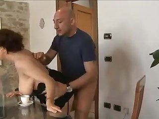 Curvy Italian in boots and stockings fucked