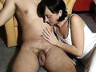 Sexy wife in a white dress puts her skillful hands to work