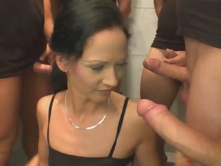 Trying to take all the dicks in her mouth she can.