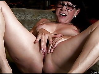 Beautiful brunette old spunker plays with her juicy pussy