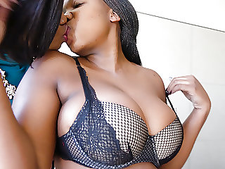 Busty black lesbian babes licking pussy