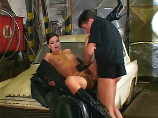 Leather couple fucks on a broke ass car