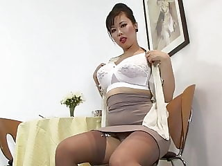 This Lady in Nylons and Garters Seeks Some Male Company