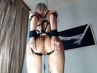 In bondage harness toyed and fucked