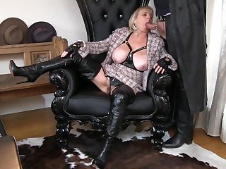 Thigh Booted MILF Sucking Cock