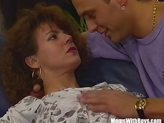 A Hairy Pussied Brunette MILF Fucked In The Couch